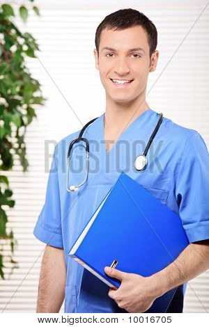 Smiling Healthcare Professional Holding A Folder Of Patient