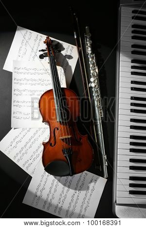 Musical instruments with music notes on dark background