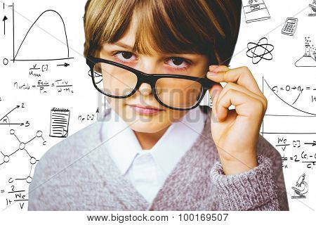 Cute pupil pretending to be teacher against math and science doodles