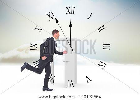 Businessman running against opening door in sky