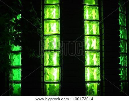 Decorative Wall With Green Glowing At Night