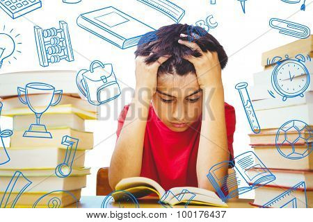 Tensed boy sitting with stack of books against school doodles