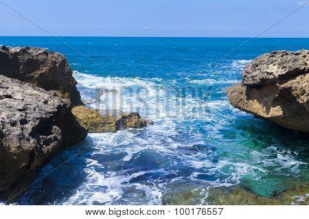 Foamy Waves Between Huge Rocks