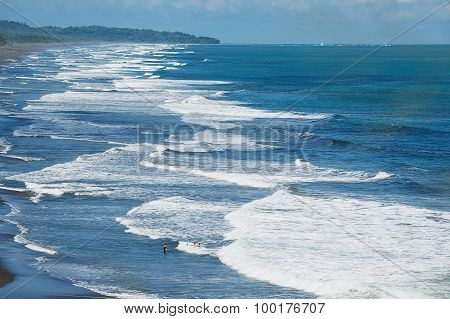 People bathe in the Pacific ocean in Jaco, Costa Rica.