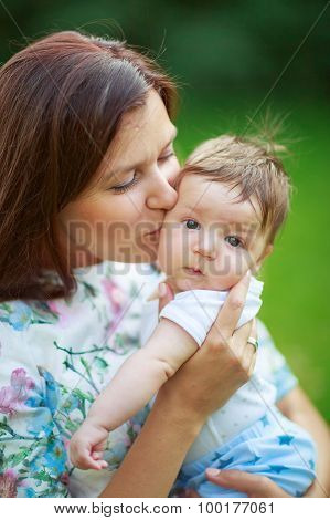Mother Kisses Baby Son, Close-up, Summer