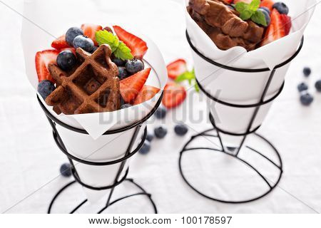 Small chocolate waffles in cones