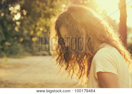 Portrait Of A Young Woman In Sunlight