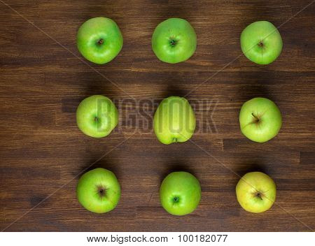 green appples on dark wooden background. Top view