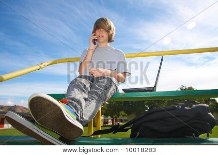 Teen With Cell Phone On Bleachers