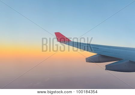 Wing Of Airplane And Sunrise Sky