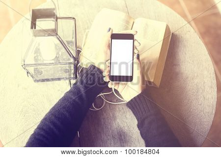 Girl With Blank Cell Phone, Headphones And A Book, Mock Up