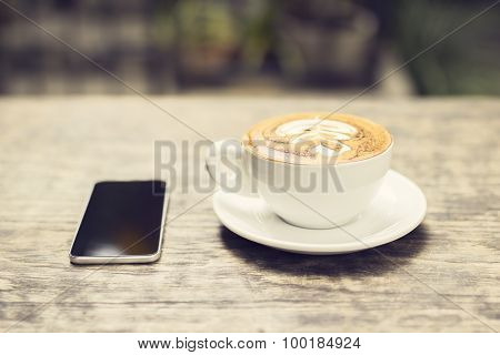 Cappuccino And A Cell Phone Outdoor