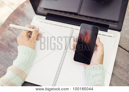 Girl With Blank Notebook And A Cell Phone