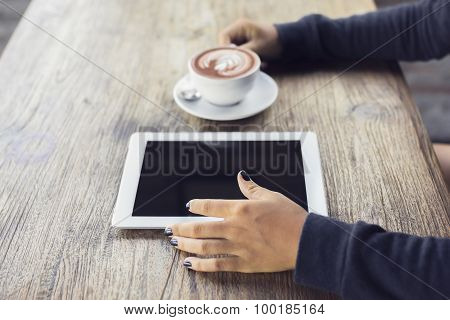 Girl Hands, Digital Tablet And Coffee On A Wooden Table
