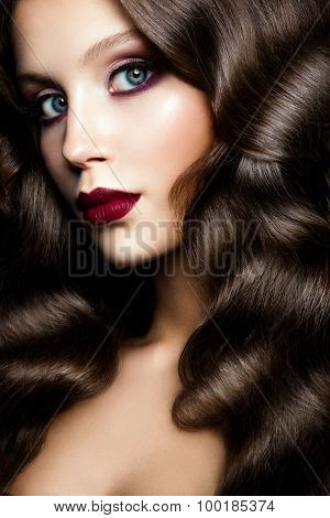 Girl with curly hair. Fashion portrait