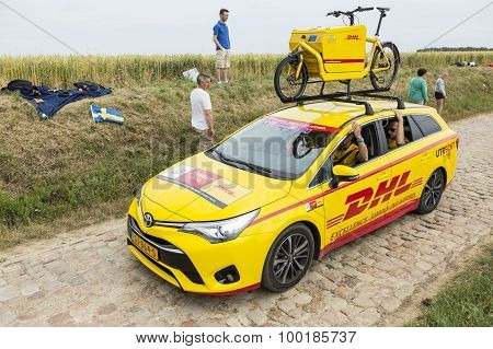 DHL Vehicle On A Cobblestone Road- Tour De France 2015
