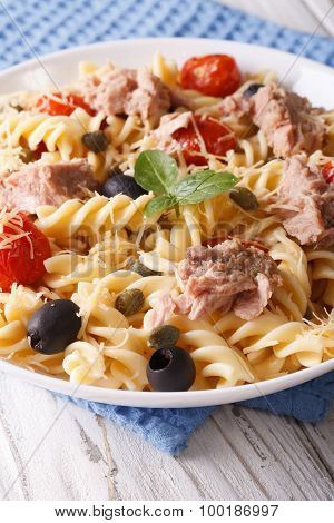 Fusilli Pasta With Tuna, Parmesan And Tomatoes In A Bowl Close Up.