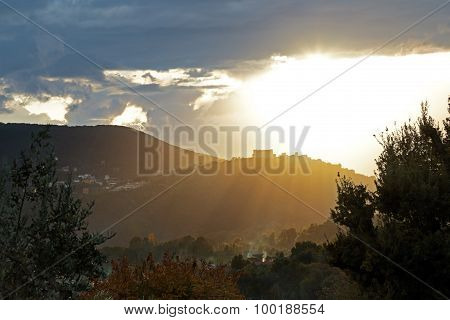 Sun Rays On A Small Town