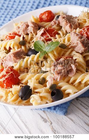 Warm Salad Fusilli Pasta, Tuna And Tomatoes Close Up. Vertical