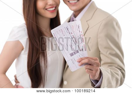 Happy Couple With Boarding Passes