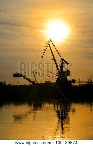 Industrial Area With Cranes