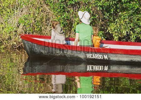 People visit Tortuguero National Park by boat in Tortuguero, Costa Rica.