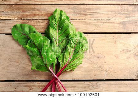 Fresh swiss chard on wooden table, close up