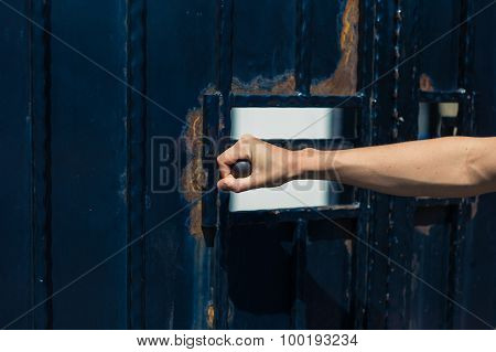 Female Hand Opening A Gate