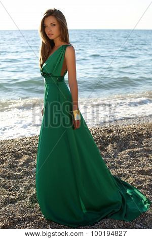 Beautiful Girl With Blond Hair Wears Luxurious Green Dress