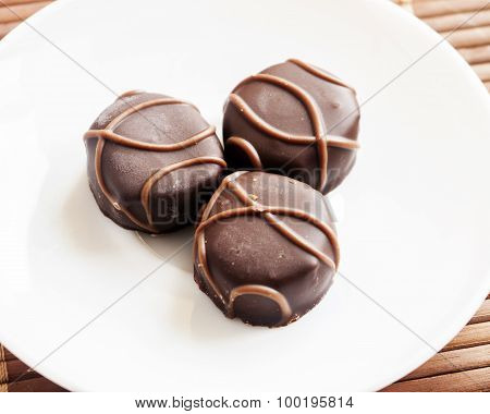 Tasty chocolate bonbon isolated on a white background