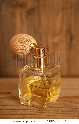 Perfume. Glass vintage perfume bottle with wooden background.
