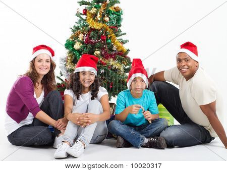 young family around christmas tree