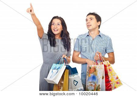 Surprised Couple At Shopping Pointing Up