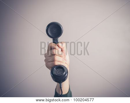 Hand Of Young Man Holding Vintage Phone