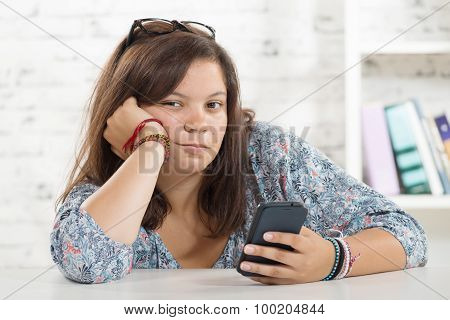 Portrait Of A Teenager With Her Phone