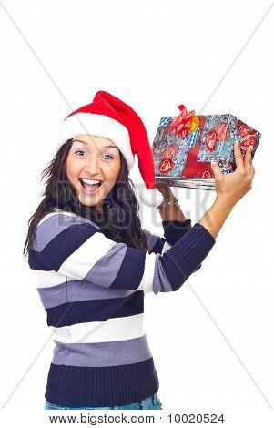 Amazed Woman Lifting Christmas Gift