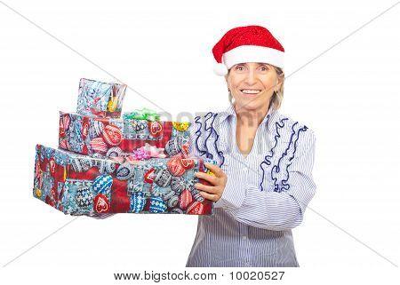 Senior Woman Holding Christmas Gifts