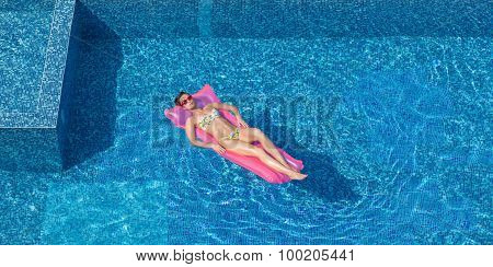 Young Brunette Woman Napping On Pink Mattress In Swimming Pool