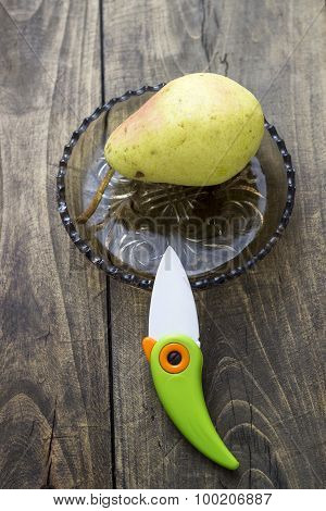 Pears And Knife On Old Wooden Surface