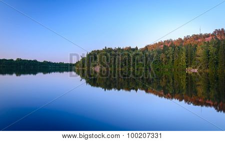 Lake evening sunset reflected in water Finland and the Aland Islands