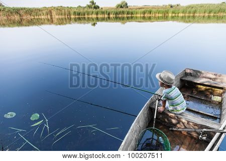 Boy Catching Fish On Fish-rod