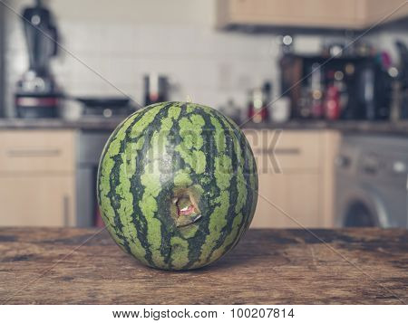 Bruised Watermelon In Kitchen