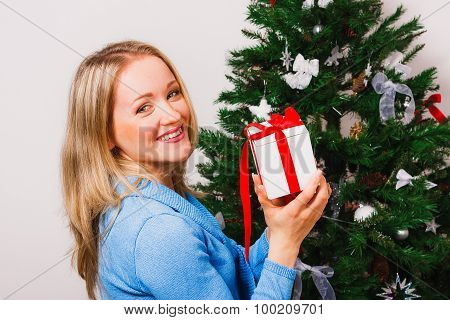 Close up of beautiful girl with small present