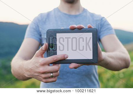 Man`s Hands Hold Electronic Book And Touches The Screen