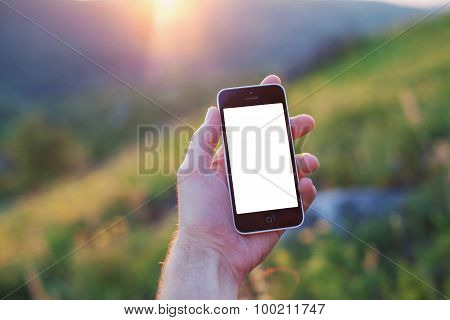Men's Left Hand Is Holding A Phone With The White Screen