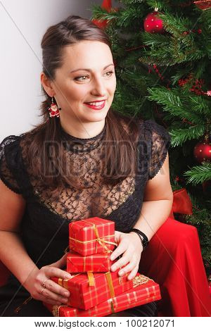 Lovely woman with a pile of presents