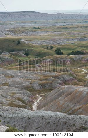 Badlands Formation And Creek