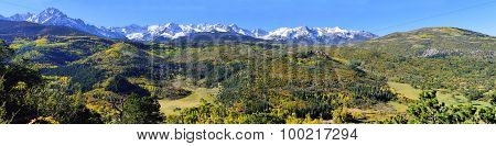 Wide Panoramic View Of The Alpine Scenery And Snow Covered Mountains During Foliage Season