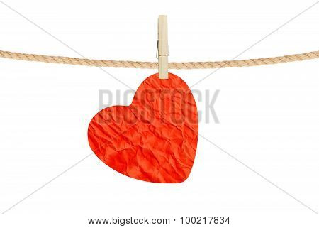 Crumpled Paper Heart Hanging On Rope On White Background