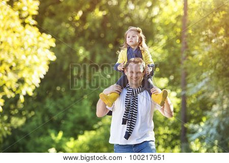 Happy father with his daughter in nature